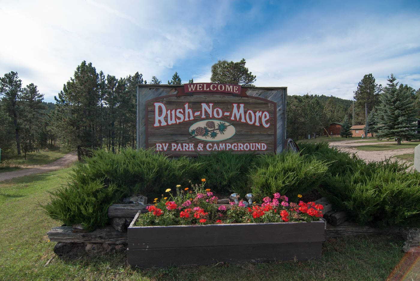 Entrance Sign (flowers) Rush No More Campground and Cabins Sturgis SD